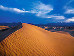 Sand Dunes And Mountains In Early Morning Light At Stovepipe Wells In Death Valley National Park, California, USA