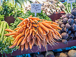 Fresh carrots. Market in old quebec city with French signage.