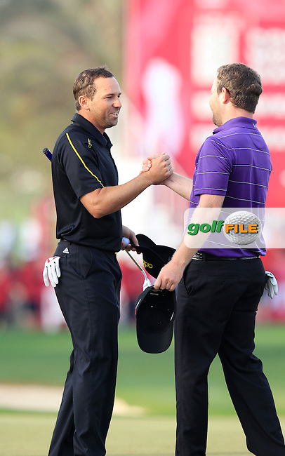 Sergio Garcia (ESP) and Branden Grace (RSA) finish their match on the 18th green during Sunday's Final Round of the Commercial Bank Qatar Masters 2013 at Doha Golf Club, Doha, Qatar 26th January 2013 .Photo Eoin Clarke/www.golffile.ie