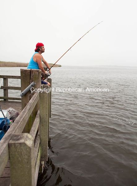OLD LYME, CT-15 July 2014-071514BF06- Tom Northrop from Waterbury, top, shows his son Gabriel Northrop, 5, keep on eye on the water in the Connecticut River near the DEEP Marine Fisheries Headquarters in Old Lyme Tuesday. This season hasn't been as productive for sports fish. The two have been coming fishing about twice per week since school got out for the summer.     Bob Falcetti Republican-American