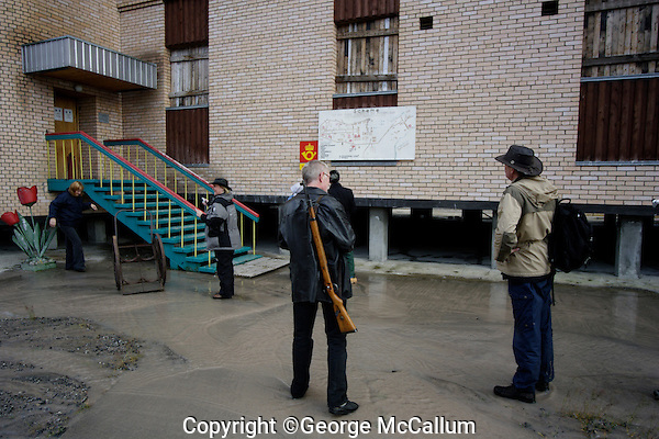 Ecotourists visiting Pyramiden abandoned Russian mining town
