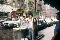 A fish monger on Prince Street in the Soho neighborhood of New York is seen on May 1, 1980. (© Frances M. Roberts)
