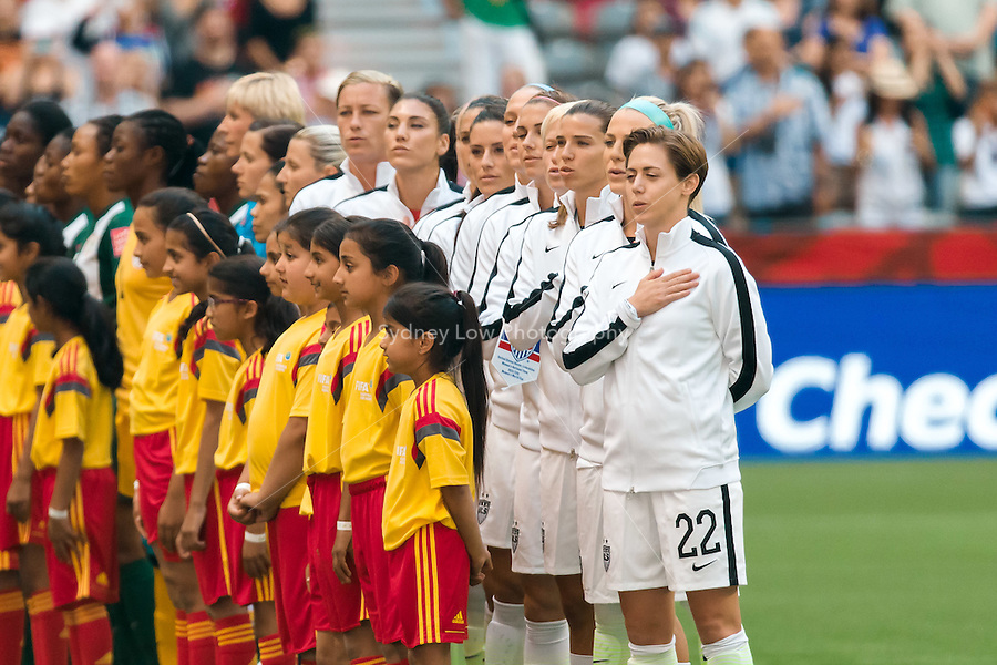 June 16, 2015: The USA team sings the national anthem prior to a Group D match at the FIFA Women's World Cup Canada 2015 between Nigeria and the USA at BC Place Stadium on 16 June 2015 in Vancouver, Canada. Sydney Low/Asteriskimages.com