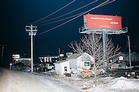 """A billboard bearing a quote from Republican presidential candidate and former Florida governor Jeb Bush reads """"Donald Trump is unhinged,"""" in Manchester, New Hampshire, on Sun., Feb. 7, 2016. The billboard is located in the parking lot of the NH campaign headquarters of Ohio governor and rival Republican presidential candidate John Kasich."""