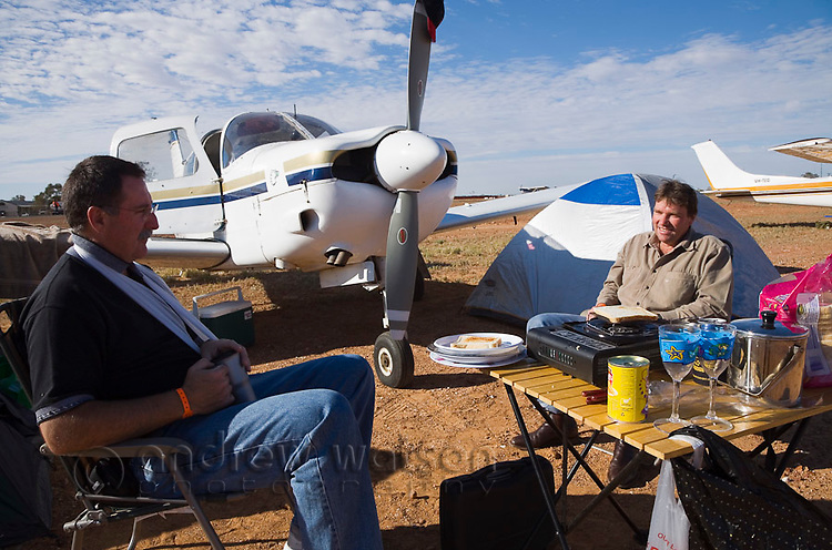 Race goers set up camp next to their aircraft during the annual Birdsville Races.  Every September hundreds of aircraft arrive at the remote town in southwest Queensland for the most famous horse racing carnival in outback Australia.  Birdsville, Queensland, AUSTRALIA.