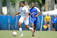 2 October 2011:  FIU forward Colby Burdette (2) moves the ball upfield while being pursued by Kentucky midfielder Josh McCrary (17) in the second half as the FIU Golden Panthers defeated the University of Kentucky Wildcats, 1-0 in overtime, at University Park Stadium in Miami, Florida.