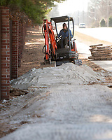 NWA Democrat-Gazette/BEN GOFF @NWABENGOFF<br /> Matt Torvinen works with a crew from Rock Solid Trail Contracting, LLC, to build new flow features Friday, Jan. 5, 2018, on the Ozone trail in Bentonville. The new features will make a more interesting line for riders on the relatively straight and flat section of the trail, part of the Slaughter Pen mountain bike trail system, where it runs beside Northwest A Street.