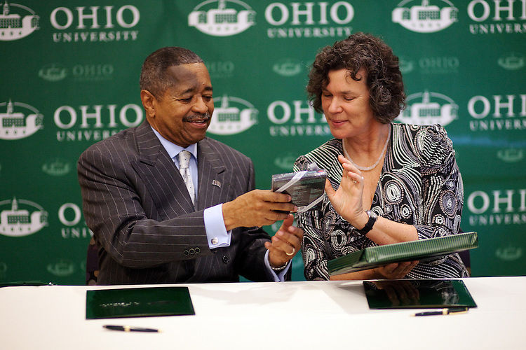 Leipzig University President Beate A. Schücking  and Ohio University President McDavis exchange gifts during a Memorandum of Understanding between LU and Ohio University in the Multicultural Center's multipurpose room in Baker Center on Monday, September 24, 2012..Photo by Chris Franz