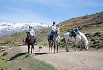 People horse riding in Sierra Nevada Mountains, High Alpujarras, Granada Province, Spain