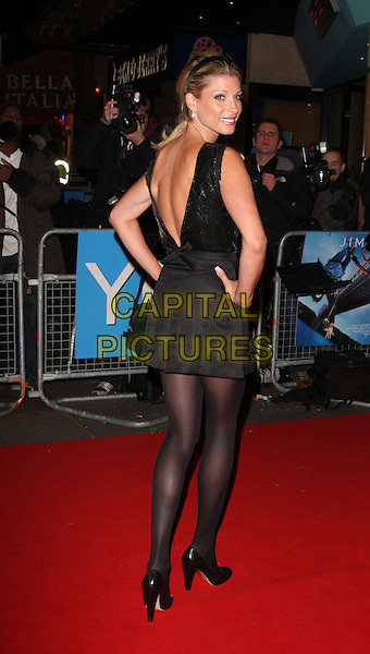 "DANI BEHR .World Premiere of ""Yes Man"" at the Vue Cinema, Leicester Square, London, England, December 9th 2008..full length black sequined top skirt mini back rear behind over shoulder tights shoes heels hands on hips  .CAP/ROS.©Steve Ross/Capital Pictures"