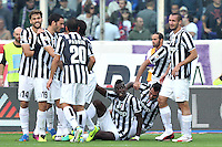 FLORENCE, Italy: October 20, 2013: AC Fiorentina beats FC Juventus 4-2 during the Serie A match played in the Artemio Franchi Stadium. In the photo Juventus players celebrating the goal scored by Paul Pogba