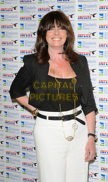VICKI MICHELLE .Attending Lionel Blair's 60th Year In Showbiz party, The Dorchester hotel, Park Lane, London, England, UK, .May 31st 2009..half length black shirt hand on hip belt jacket white trousers gold leaf necklace bolero .CAP/CAN.©Can Nguyen/Capital Pictures
