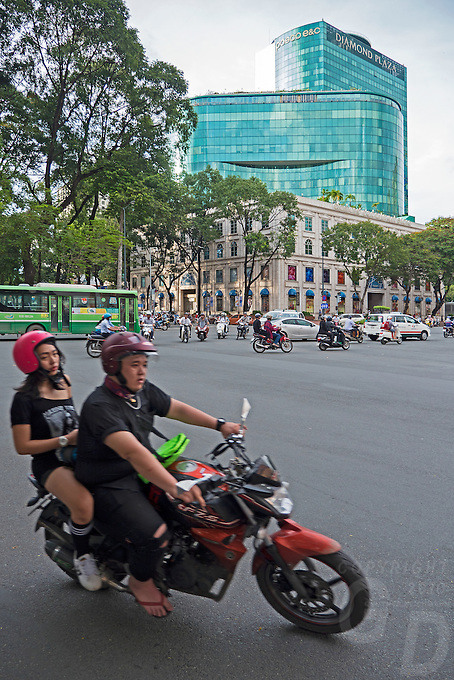 Street Life in Saigon or in Vietnamese Ho Chi Minh City where old and new architecture mix in harmony. The bustling Metropolis of South Vietnam.