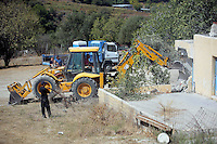 Pictured: A digger is used to demolish part of the house where Ben Needham disappeared from in Kos, Greece. Tuesday 04 October 2016<br />