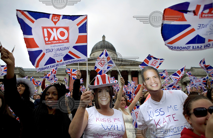 People sing the national anthem and wave flags while celebrating in Trafalgar Square, London during the Royal Wedding between Britain's Prince William and Kate Middleton..