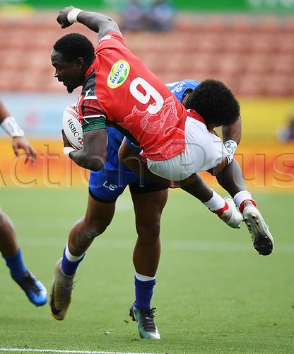 3rd February 2018, FMG Stadium, Waikato, Hamilton, New Zealand; HSBC World Rugby Sevens Series;  Samoa's Joe Perez tackles Kenya's Nelson Oyoo; Kenya versus Samoa