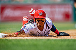 14 April 2018: Washington Nationals infielder Wilmer Difo dives safely back to first on a pickoff attempt by the Colorado Rockies at Nationals Park in Washington, DC. The Nationals rallied to defeat the Rockies 6-2 in the 3rd game of their 4-game series. Mandatory Credit: Ed Wolfstein Photo *** RAW (NEF) Image File Available ***