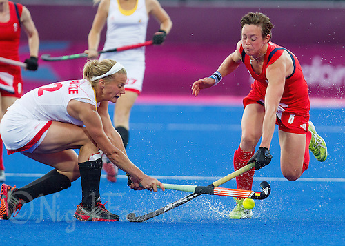 02 AUG 2012 - LONDON, GBR - Hannah Macleod (GBR) (right) of Great Britain and Gaelle Valcke (BEL) (left) of Belgium clash during the London 2012 Olympic Games preliminary round hockey match between the two countries at the Riverbank Arena in the Olympic Park at Stratford, Great Britain (PHOTO (C) 2012 NIGEL FARROW)