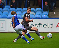 Lincoln City's Harry Toffolo vies for possession with Macclesfield Town's Tyrone Marsh<br /> <br /> Photographer Andrew Vaughan/CameraSport<br /> <br /> The EFL Sky Bet League One - Macclesfield Town v Lincoln City - Saturday 15th September 2018 - Moss Rose - Macclesfield<br /> <br /> World Copyright &copy; 2018 CameraSport. All rights reserved. 43 Linden Ave. Countesthorpe. Leicester. England. LE8 5PG - Tel: +44 (0) 116 277 4147 - admin@camerasport.com - www.camerasport.com
