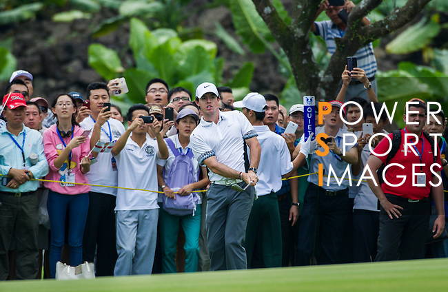 Tiger Woods and Rory McIlroy in action during 'The Match' golf duel on the Blackstone Course on October 28, 2013 at Mission Hills Golf Club in Haikou, China. Photo by Victor Fraile / The Power of Sport Images