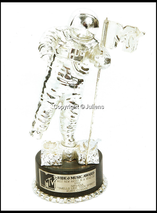 BNPS.co.uk (01202 558833)<br /> Pic: Juliens/Casemate<br /> <br /> Cobain's 1992 MTV award he used as a doorstop - £50,000.<br /> <br /> A relative of the late Kurt Cobain is selling a huge collection of the late rock star's belongings worth around £80,000.<br /> <br /> The 26-lot collection offers an insight into the troubled star's life and career, and is made up of a variety of awards, notes, clothing and memorabilia.<br /> <br /> A number of the lots would appear to contradict the rock hero's wild public persona, including a Blockbuster video card, belonging to Cobain during the early 90s.