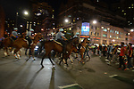 A demonstrator ducks out of the way as police end the sit in by charging at demonstrators with horses at the intersection of Roosevelt and State Street in the South Loop in Chicago, Illinois on July 9, 2016.  Protests erupted nationwide following the police shootings of Alton Sterling who was selling bootleg DVDs outside a convenience store in Baton Rouge, Louisiana and Philando Castile during a routine traffic stop for a broken tail light in the St. Paul, Minneapolis suburb of Falcon Heights; on Thursday night, a lone gunman Micah Johnson fired and killed five police officers and injured several others during a Black Lives Matter protest in Dallas.