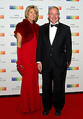Stephen A. Schwarzman, Chairman and CEO of the Blackstone Group, and his wife, Christine arrive for the formal Artist's Dinner honoring the recipients of the 38th Annual Kennedy Center Honors hosted by United States Secretary of State John F. Kerry at the U.S. Department of State in Washington, D.C. on Saturday, December 5, 2015. The 2015 honorees are: singer-songwriter Carole King, filmmaker George Lucas, actress and singer Rita Moreno, conductor Seiji Ozawa, and actress and Broadway star Cicely Tyson.<br /> Credit: Ron Sachs / Pool via CNP