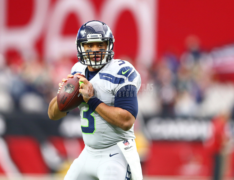 Jan 3, 2016; Glendale, AZ, USA; Seattle Seahawks quarterback Russell Wilson warms up prior to the game against the Arizona Cardinals at University of Phoenix Stadium. Mandatory Credit: Mark J. Rebilas-USA TODAY Sports