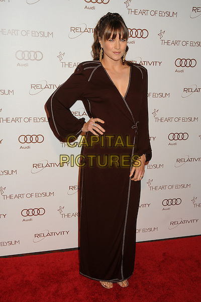 Lucy Lawless.5th Annual Art Of Elysium Heaven Gala held at Union Station, Los Angeles, California, USA, 14th January 2012..arrivals full length hand on hip brown long sleeve maxi dress .CAP/ADM/BP.©Byron Purvis/AdMedia/Capital Pictures.