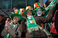 Maria Brown (l) Ciara Carlin (m)  Marc Hutton all from Ireland watch the parade.  246th Saint Patrick's Day Parade,  marches up 5th Avenue,  March 17, 2007.  (© Frances Roberts)