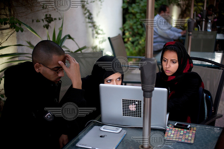 Sarah Jamal Ahmed, a 24 year old sociologist who was one of the activists leading the charge on Change Square in Sana'a, meets with friends at Coffee Corner to blog and make online connections.