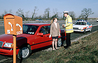 Traffic police officers with their police rapid response traffic vehicle attending an emergency call from a lone female stranded on the motorway, who used the emergency telephone on the hard shoulder to call for assistance when her car broke down...© SHOUT. THIS PICTURE MUST ONLY BE USED TO ILLUSTRATE THE EMERGENCY SERVICES IN A POSITIVE MANNER. CONTACT JOHN CALLAN. Exact date unknown.john@shoutpictures.com.www.shoutpictures.com...