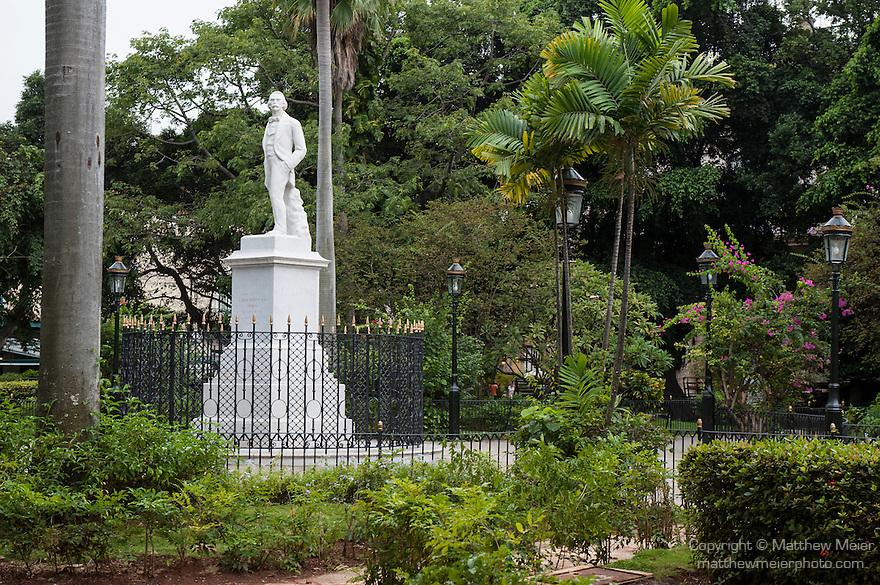 Havana, Cuba; a white marble statue of Manuel de Cespedes stands in the center of Parque Cespedes in the Plaza de Armas