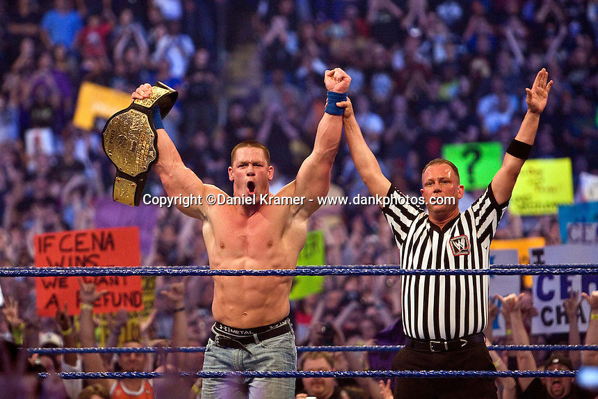 John Cena celebrates his victory over Big Show and Edge in a Triple Threat match to win the World Heavyweight Championship at WrestleMania 25 at Reliant Stadium on April 5, 2009 in Houston, Texas..