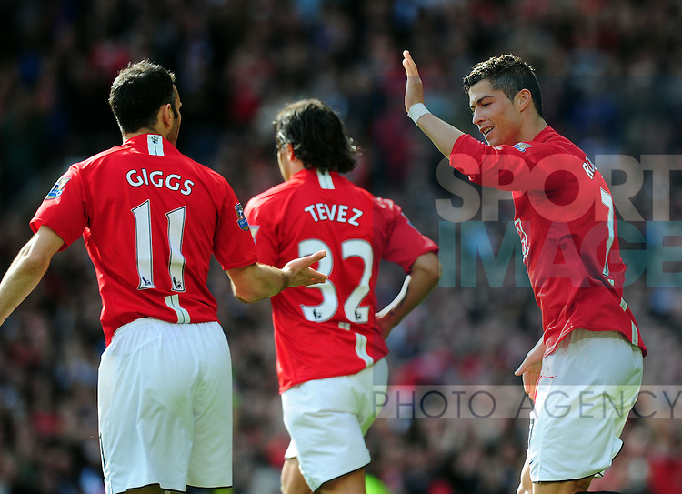 Cristiano Ronaldo of Manchester United celebrates his first goal with Ryan Giggs of Manchester United