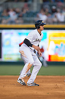 Trayce Thompson (15) of the Charlotte Knights takes his lead off of second base against the Norfolk Tides at BB&T BallPark on April 9, 2015 in Charlotte, North Carolina.  The Knights defeated the Tides 6-3.   (Brian Westerholt/Four Seam Images)