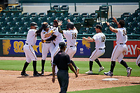 Bradenton Marauders Jesse Medrano (3) is mobbed by teammates, including Adrian Valerio (2), Gregory Polanco (48), Chris Sharpe (18), Travis Swaggerty (12), and Cal Mitchell (34) after a walk off bunt base hit during a Florida State League game against the Charlotte Stone Crabs on April 10, 2019 at LECOM Park in Bradenton, Florida.  Bradenton defeated Charlotte 2-1.  (Mike Janes/Four Seam Images)