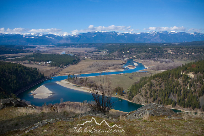 Idaho, North, Boundary County, Bonners Ferry. The Kootenai River and valley with snowcapped Selkirk Mountains distant in late winter.