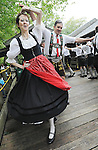 Holly Herro of Bethesda spins as she and Kent Hibben of Accokeek, right do a traditional German dance with the rest of Alt Washingtonin which translates from german to english to Original Washingtonians at the 29th Annual Oktoberfest hosted by Hard Bargain Farm in Accokeek on Saturday.