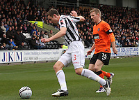 Paul Dummett clears under pressure from Michael Gardyne in the St Mirren v Dundee United Clydesdale Bank Scottish Premier League match played at St Mirren Park, Paisley on 27.10.12.