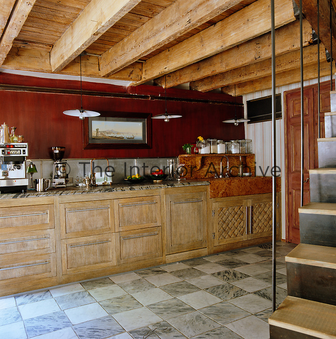 Everything from the kitchen cabinets to the granite sink  in this country-style basement kitchen was sourced in Italy