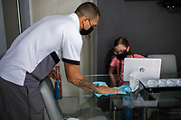 HERMOSILLO, MEXICO - MAY 08: Oscar Rai Villa de los Cimarrones De Sonora sanitizes the dining room and living room of his house while his 8-year-old daughter Abril Maribel plays on the computer in the middle of the Coronavirus pandemic on May 8, 2020 in Hermosillo, Mexico. Due to the Coronavirus crisis the Liga MX has announced the cancellation of the Ascenso MX 2019-2020 season and to temporarily suspend promotions and relegations for the next six seasons. (Photo by Luis Gutierrez/Norte Photo/Getty Images)