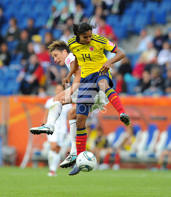 Abby Wambach (l) of team USA and Kelis Peduzine of team Columbia during the FIFA Women's World Cup at the FIFA Stadium in Sinsheim, Germany on July 2nd, 2011.