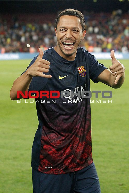 FC Barcelona's Adriano Correia celebrates the victory in the Supercup of Spain.August 28,2013. Foto © nph / Acero)