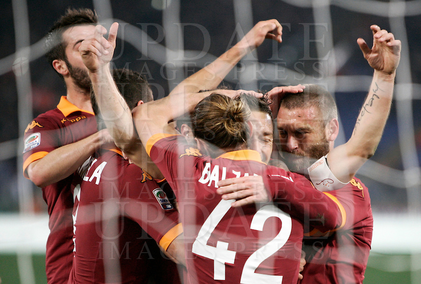 Calcio, Serie A: Roma vs Genoa. Roma, stadio Olimpico, 3 marzo 2013..AS Roma forward Francesco Tott, second from right, is hugged by teammates after scoring  on a penalty kick during the Italian Serie A football match between AS Roma and Genoa at Rome's Olympic stadium, 3 March 2013..UPDATE IMAGES PRESS/Riccardo De Luca