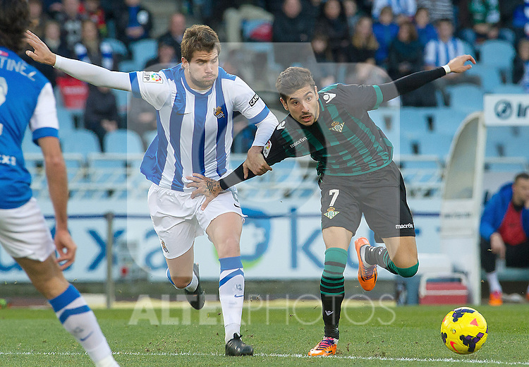 Real Sociedad's Inigo Martinez (l) and Betis' Alvaro Vadillo during La Liga match.November 23,2013. (ALTERPHOTOS/Mikel)