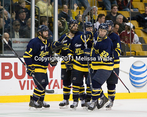Karl Stollery (Merrimack - 7), Ryan Flanigan (Merrimack - 20), Elliott Sheen (Merrimack - 11), Brendan Ellis (Merrimack - 22) and Carter Madsen (Merrimack - 9) celebrate Flanigan's goal. - The Merrimack College Warriors defeated the University of New Hampshire Wildcats 4-1 (EN) in their Hockey East Semi-Final on Friday, March 18, 2011, at TD Garden in Boston, Massachusetts.