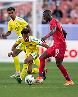 CLEVELAND, OH - JUNE 22: Abdiel Arroyo #18 and Samuel Cox #8 contest the ball during a game between Panama and Guyana at FirstEnergy Stadium on June 22, 2019 in Cleveland, Ohio.