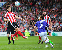Lincoln City's Alex Woodyard heads over Exeter City's Ryan Harley<br /> <br /> Photographer Andrew Vaughan/CameraSport<br /> <br /> The EFL Sky Bet League Two Play Off First Leg - Lincoln City v Exeter City - Saturday 12th May 2018 - Sincil Bank - Lincoln<br /> <br /> World Copyright &copy; 2018 CameraSport. All rights reserved. 43 Linden Ave. Countesthorpe. Leicester. England. LE8 5PG - Tel: +44 (0) 116 277 4147 - admin@camerasport.com - www.camerasport.com