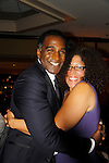"""Norm Lewis """"Keith McLean"""" on All My Children singing in Black Stars in the Great White Way poses with actress Rain Pryor at The National Black Theatre Festival with a week of plays, workshops and much more with an opening night gala of dinner, awards presentation followed by Black Stars of the Great White Way followed by a celebrity reception. It is an International Celebration and Reunion of Spirit. (Photo by Sue Coflin/Max Photos)"""